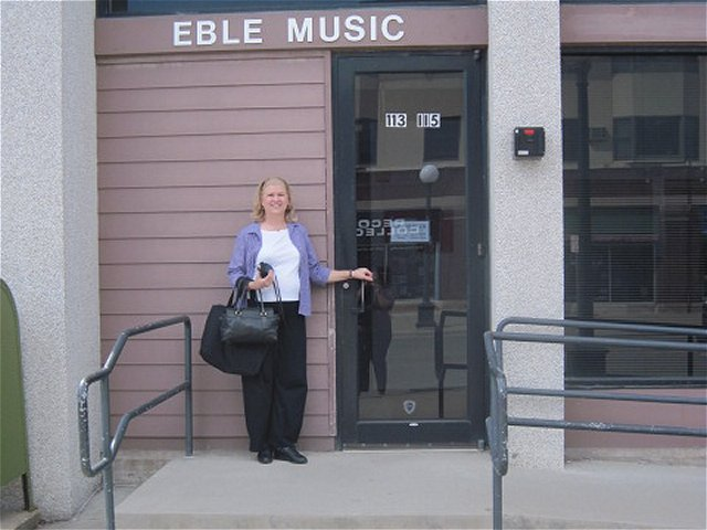 Kathy in front of Eble Music, in Iowa City, IA, a requisite visit if nearby!