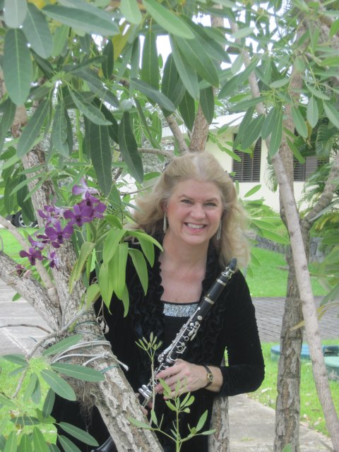 Kathy in her neighborhood, Urbanización Torrimar, where orchids grow on trees, and in June the trees put on a fabulous show of red, yellow, purple and pink blossoms. Puerto Rico has to be one of the most beautiful places on this green earth!